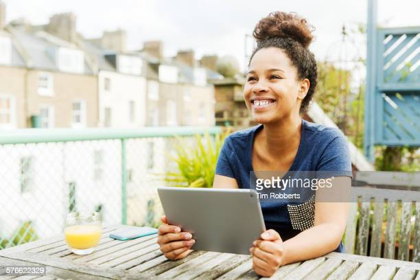 Young woman using tablet on terrace
