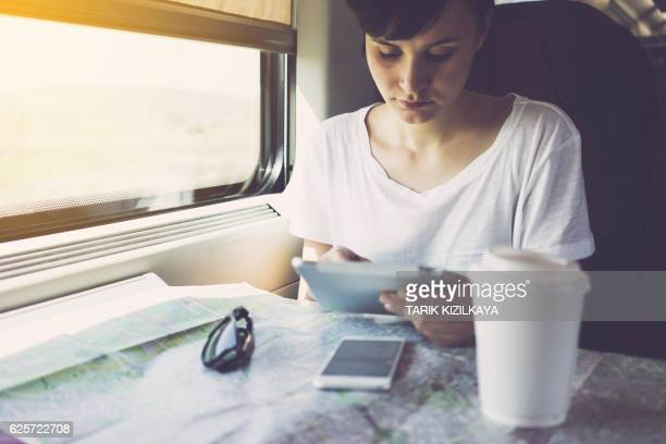 Young woman using tablet pc, mobile smart device, travelling