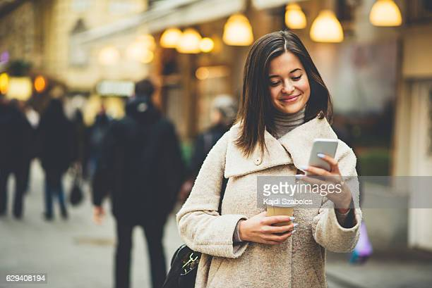 Young woman using the phone