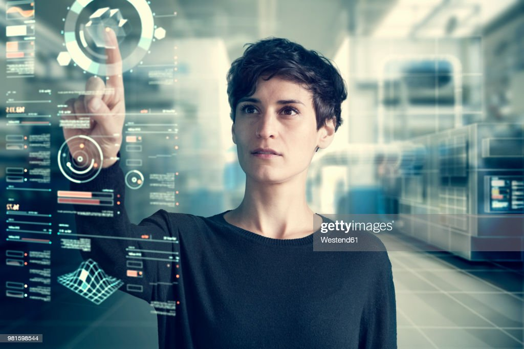 Young woman using transparent touchscreen display, Composing : Foto stock