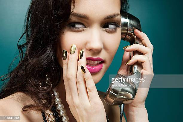 Young woman using vintage telephone