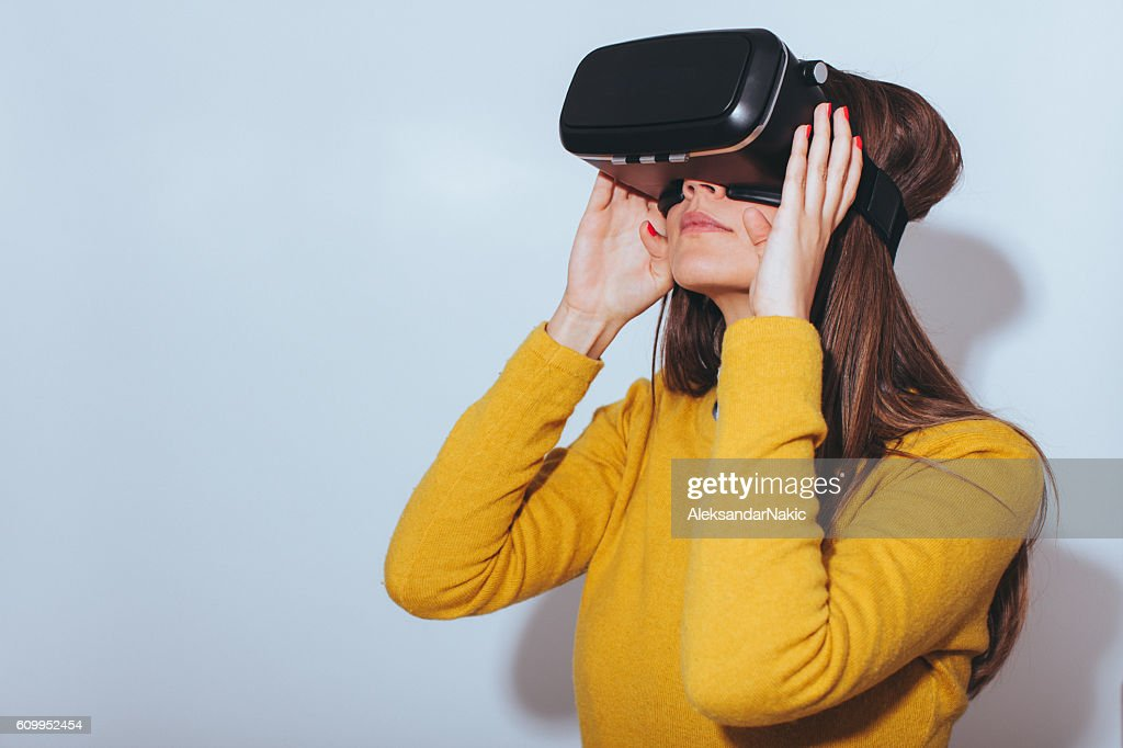 Young woman using virtual reality glasses : Stock Photo