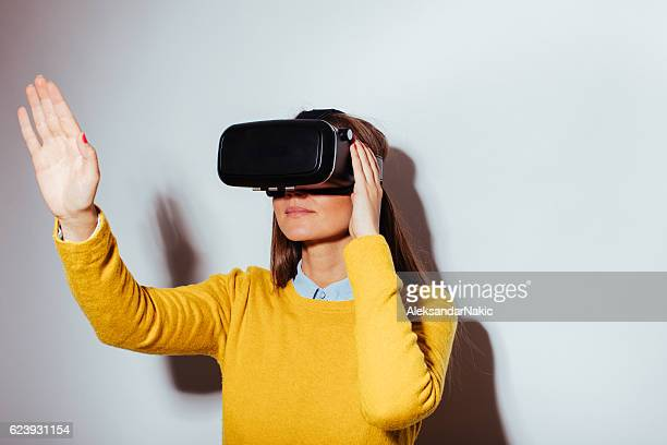 Young woman using virtual reality glasses