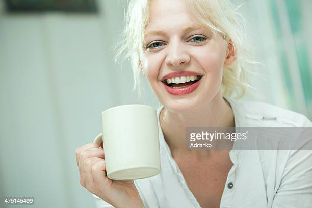 Young woman using with a coffee
