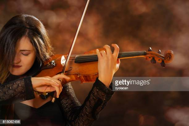 Young woman violinist during performance