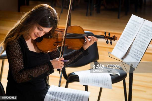 Young woman violinist practicing