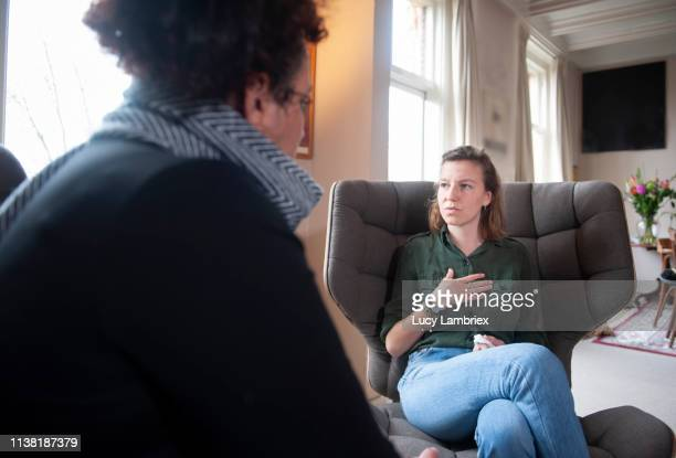young woman visiting a counselor - counseling stock pictures, royalty-free photos & images