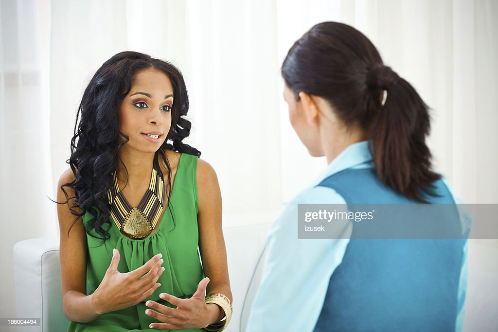 Young woman visiting a therapist : Stock Photo