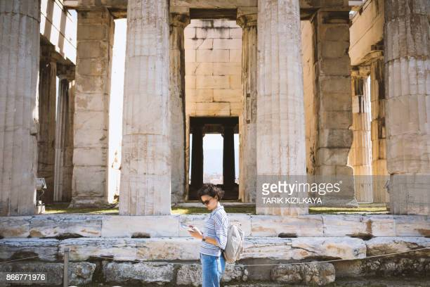 Young woman visiting Ancient Agora of Athens