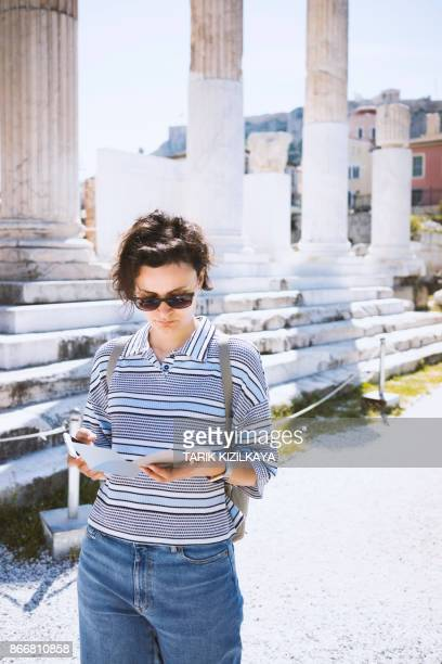 Young woman visiting historic places in Athens