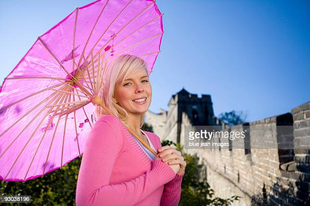 Young woman visiting the Great Wall of China