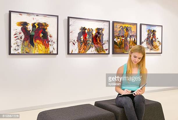 Young woman visits an art gallery