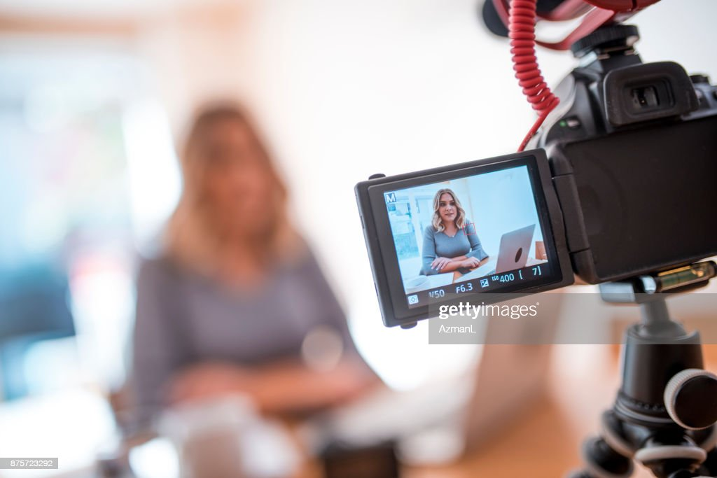 Young woman vlogging about her business life : Stock Photo