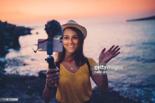 young woman vlogging from beach holiday - influencer stock pictures, royalty-free photos & images