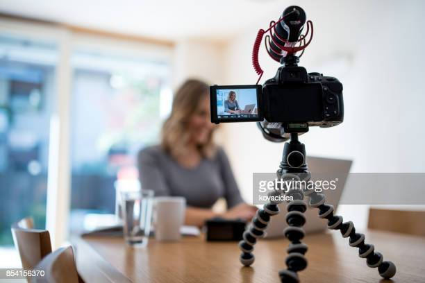 Young woman vlogging herself doing business