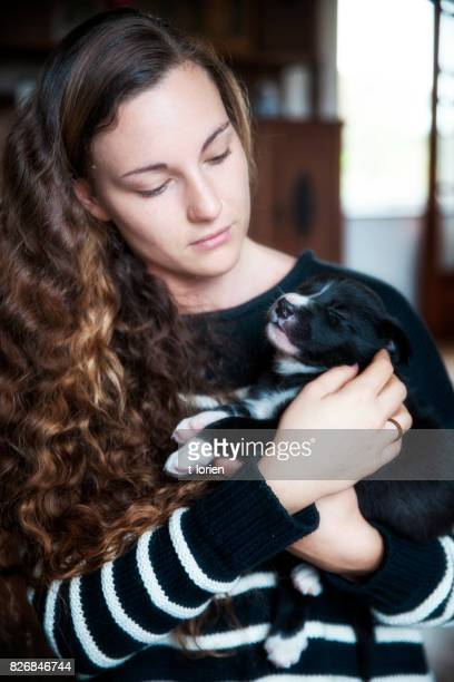 Young woman w small puppy.