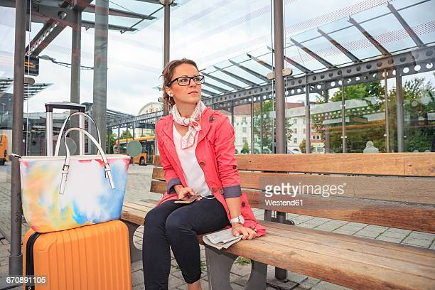 Young woman waiting at bus station