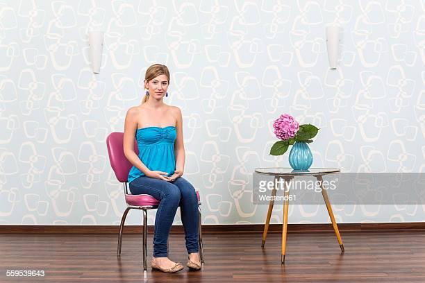 Young woman waiting at hair salon