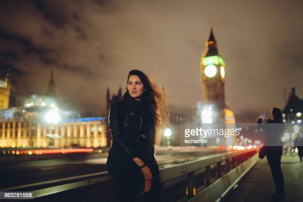 Young woman waiting for a taxi in London at night