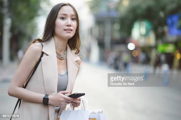 Young woman waiting for a taxi