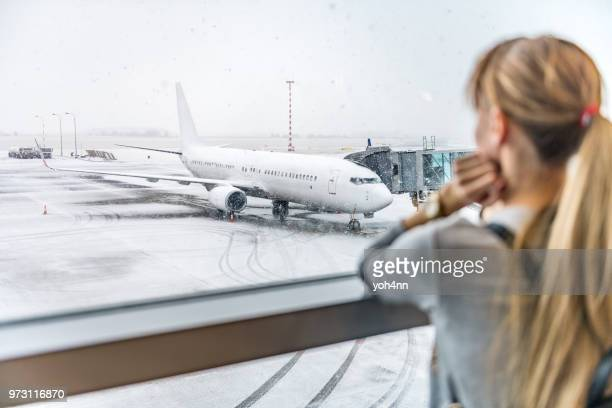 young woman waiting for boarding - christmas plane stock pictures, royalty-free photos & images