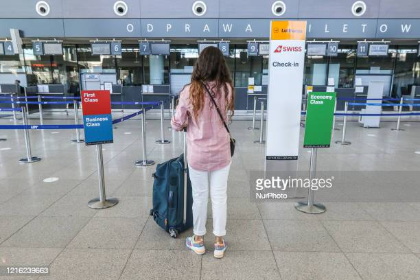 Young woman waiting for her charter flight wearing face mask due the Covid-19 pandemic is seen at the Gdansk Lech Walesa Airport in Gdansk, Poland on...