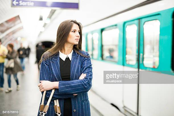 young woman waiting for the right train in the subway - moving past stock photos and pictures