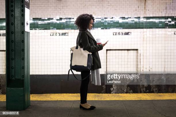young woman waiting for the subway train in new york - subway stock pictures, royalty-free photos & images