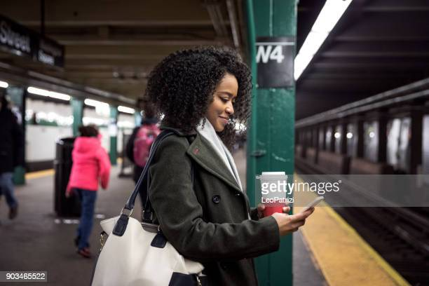 young woman waiting for the subway train in new york - new york city subway stock pictures, royalty-free photos & images