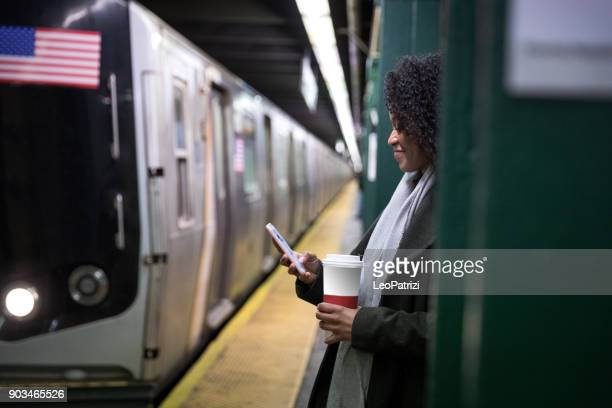 Young woman waiting for the subway train in New York