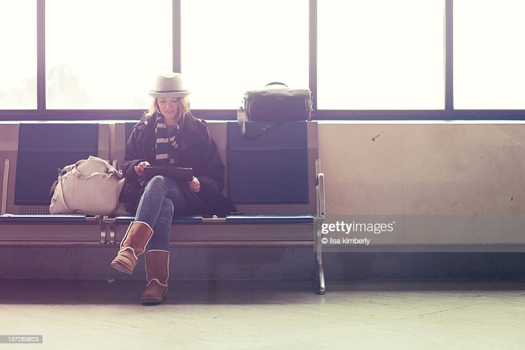 Young woman waiting in airport : Stock Photo