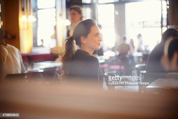 Young woman waiting in cafe bar