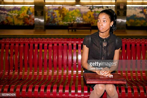 Young Woman Waiting on Subway