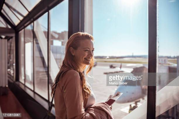 young woman waiting to board the airplane - travel stock pictures, royalty-free photos & images
