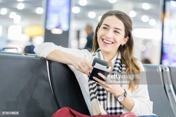Young woman waits for international flight at airport