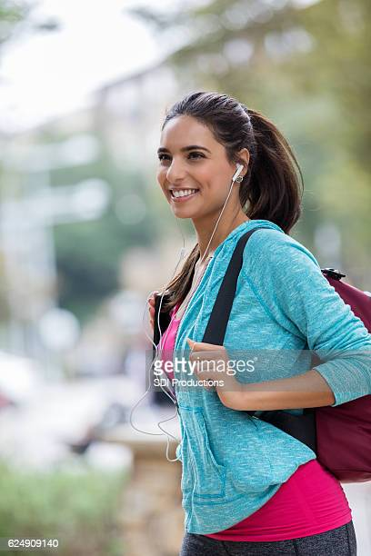 Young woman waits for ride in the city