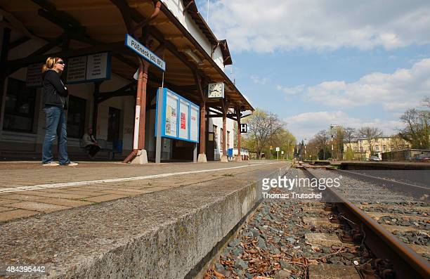 A young woman waits on the platform of train station poessneck on April 23 2008 in Poessneck Germany