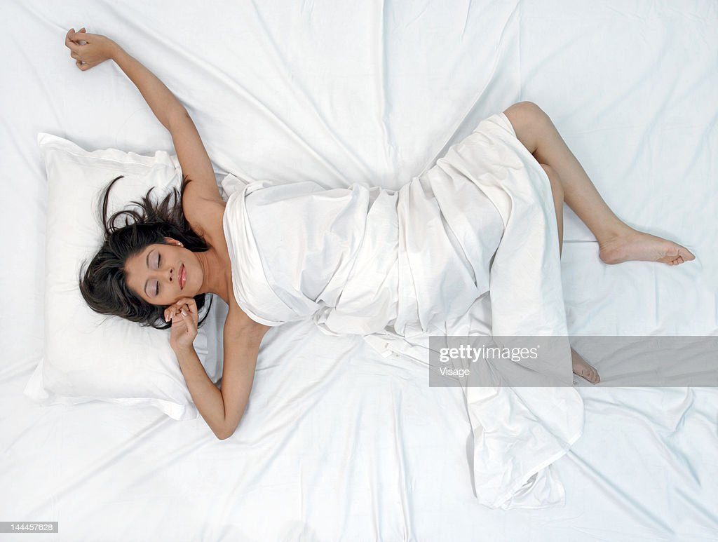 Young woman waking up from her sleep : Stock Photo