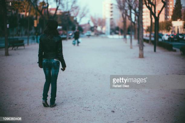 young woman walking along boulevard - reus spain ストックフォトと画像