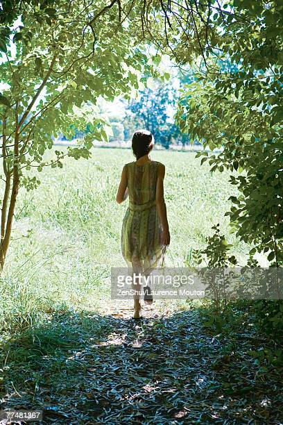 Young woman walking along rural path