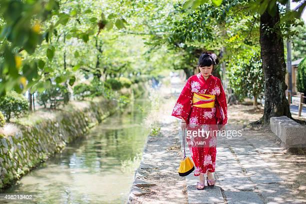 Young woman walking along the Tetsugaku-no-Michi (Path of Philosophy) with Kimono,Kyoto