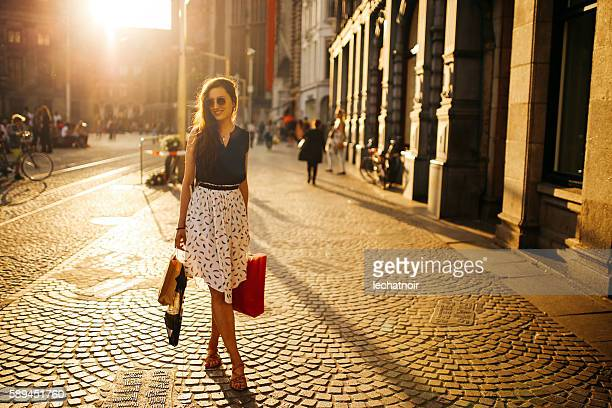 young woman walking and shopping in amsterdam - up skirts stock pictures, royalty-free photos & images