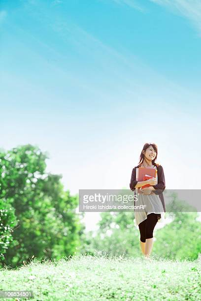 young woman walking at a park, japan - 女子大生 ストックフォトと画像