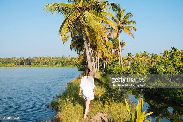 Young woman walking at Karela Backwaters near North Paravoor, Kerala, India