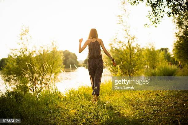 Young woman walking at lakeshore