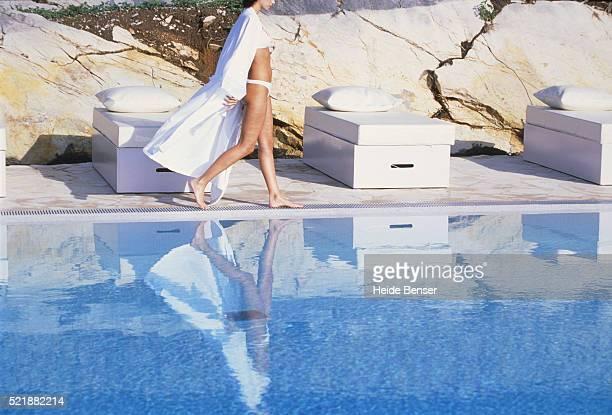 Young woman walking at pool