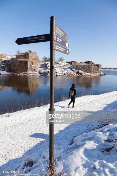 Young woman walking at Suomenlinna during winter, Finland