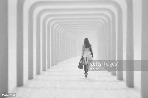 young woman walking away - leaving stock pictures, royalty-free photos & images