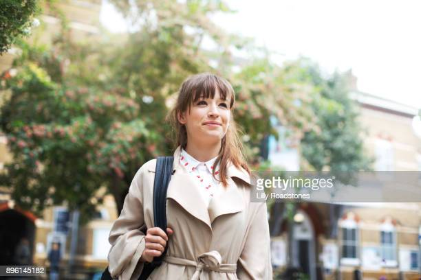 Young woman walking confidently