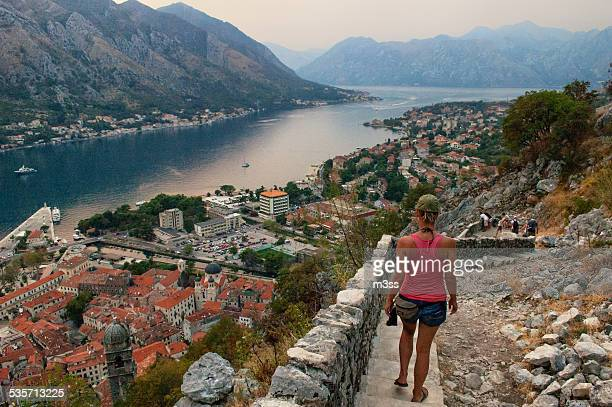 Young woman walking down the stairs in Kotor